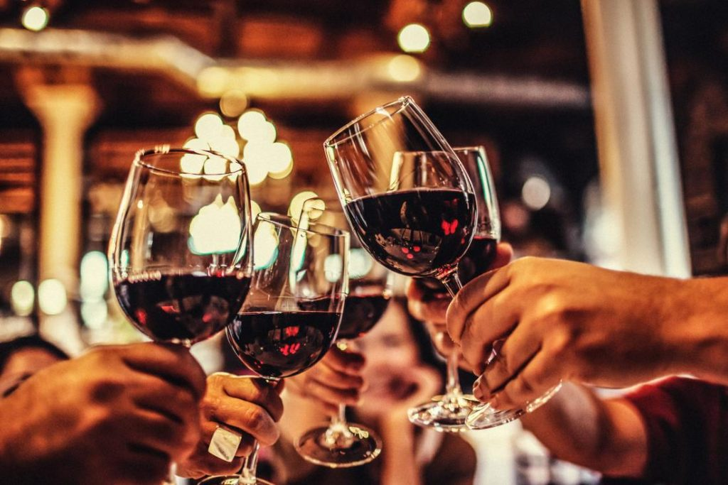 people-celebrating-with-wine-glasses