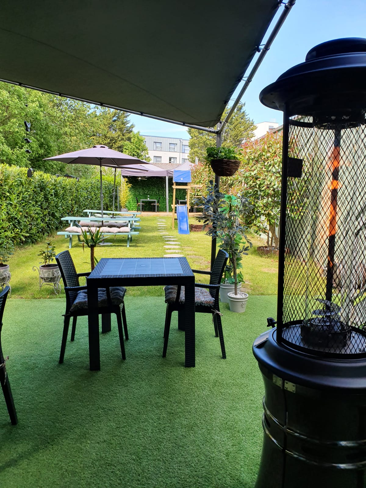 Beer Garden - Tables and Fireplace - Outdoor Dinning - Wine House Restaurant